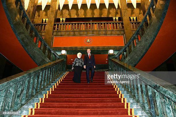 President of Republic of Turkey Recep Tayyip Erdogan and his wife Emine Erdogan go down the stairs during a reception given for the 92nd anniversary...
