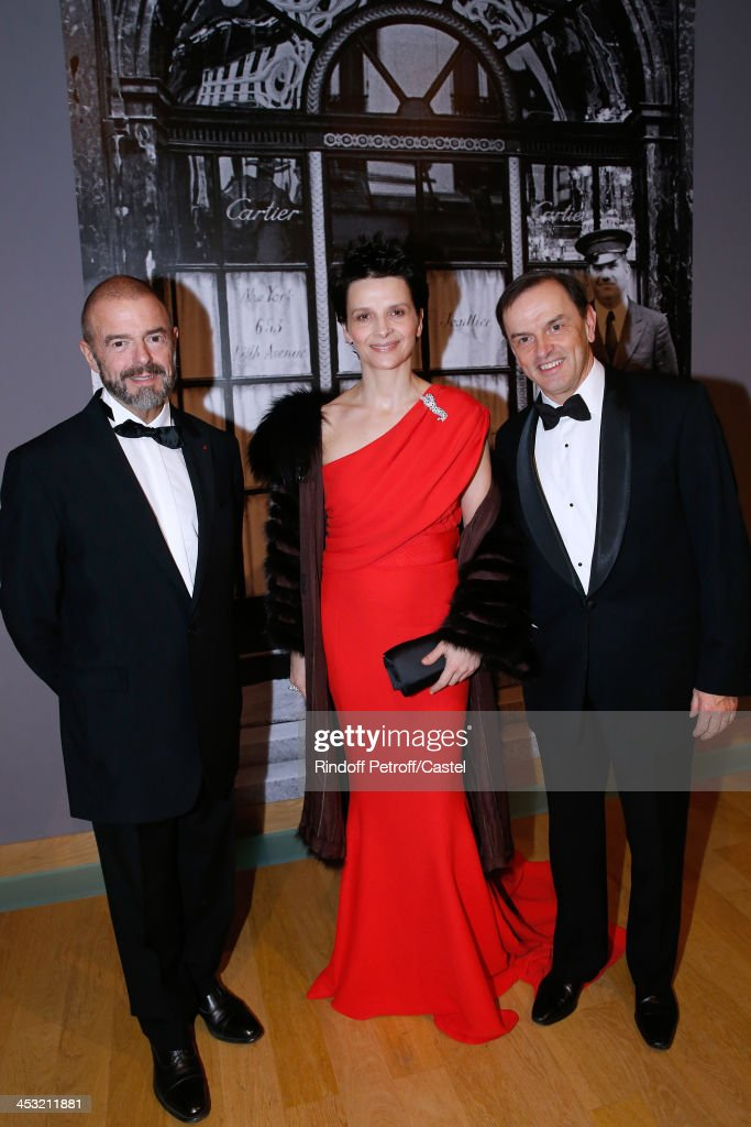 President of Reunion des Musees Nationaux (RMN) Jean-Paul Cluzel, Actress Juliette Binoche and President of Cartier Stanislas de Quercize attend the 'Cartier: Le Style et L'Histoire' Exhibition Private Opening at Le Grand Palais on December 2, 2013 in Paris, France.