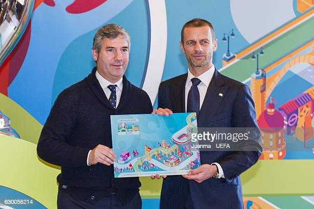 president of RFEF Angel Maria Villar and UEFA president Aleksander Ceferin pose in front of the Bilbao logo for the EURO 2020 during the official...