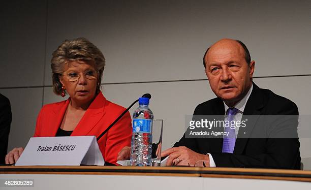 President of Romania Traian Basescu and European Commissioner responsible for justice Viviane Reding speak during European Roma Summit in Brussels...