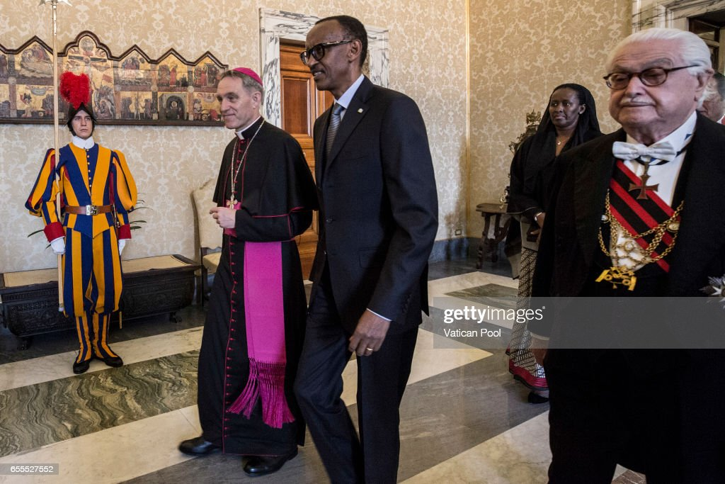 President of Ruanda Paul Kagame, flanked by the Prefect of the Pontifical House Georg Ganswein as they arrive at the Apostolic Palace to attend a meeting with Pope Francis on March 20, 2017 in Vatican City, Vatican. A statement from Greg Burke, the Director of the Holy See Press Office, has confirmed that Pope Francis will visit Egypt at the end of April.