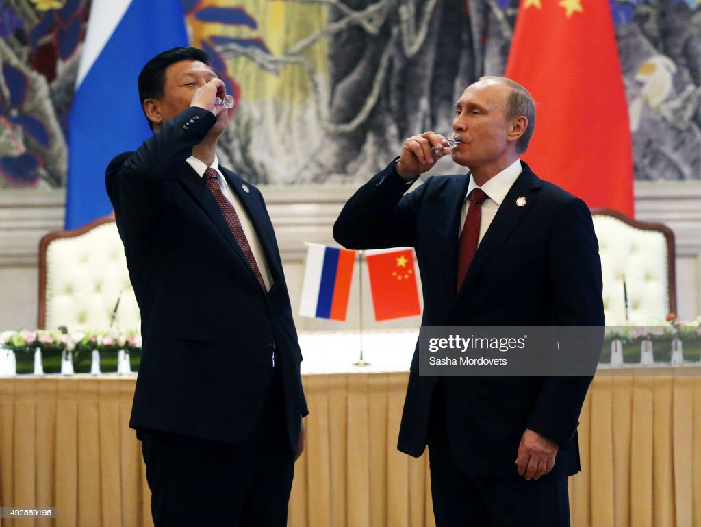 President of Russia <a gi-track='captionPersonalityLinkClicked' href=/galleries/search?phrase=Vladimir+Putin&family=editorial&specificpeople=154896 ng-click='$event.stopPropagation()'>Vladimir Putin</a> and Chinese President <a gi-track='captionPersonalityLinkClicked' href=/galleries/search?phrase=Xi+Jinping&family=editorial&specificpeople=2598986 ng-click='$event.stopPropagation()'>Xi Jinping</a> toast with vodka during a signing ceremony on May 21, 2014 in Shanghai, China. Russia and China signed a thirty-year contract for supply of gas.