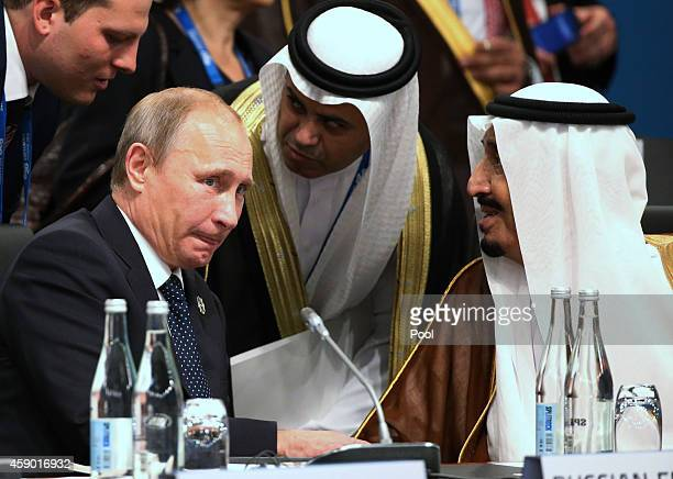 President of Russia Vladimir Putin and Crown Prince Salman bin Albdulaziz Al Saud talk through their interpreters during a plenary session at the G20...