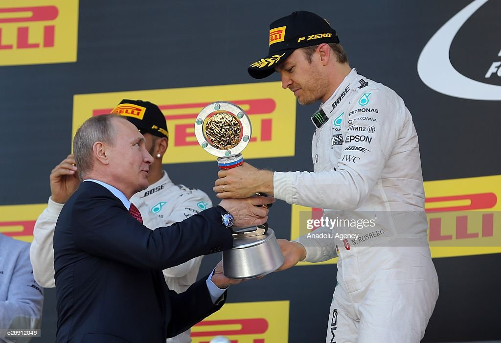 President of Russia Vladimir Putin (L) presents N. Rosberg's (R) award after the Formula One Grand Prix of Russia at Sochi Autodrom in Sochi, Russia on May 01, 2016.