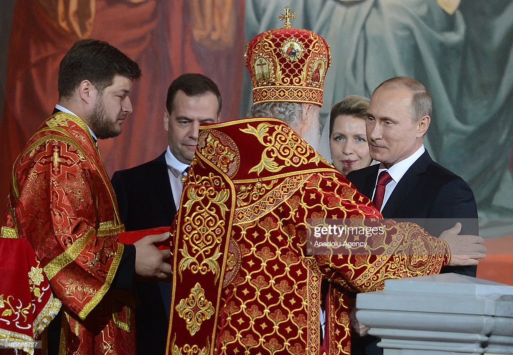 President of Russia Vladimir Putin Prime Minister of Russia Dmitry Medvedev and his wife Svetlana attend the Easter Celebration ceremony led by...