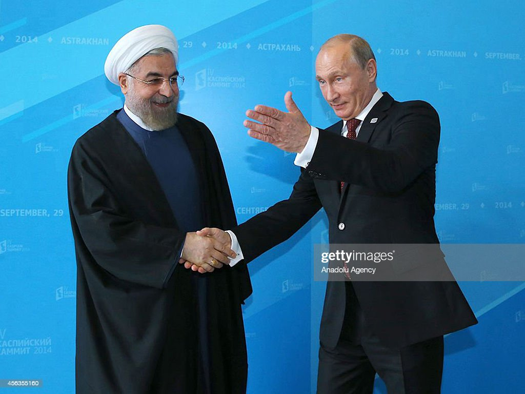 President of Russia Vladimir Putin welcomes Iranian President Hassan Rouhani during 4th Caspian Summit in Astrakhan Russia on 29 September 2014