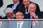 President of Russia Vladimiur Putin takes his seat next to F1 supremo Bernie Ecclestone during the Formula One Grand Prix of Russia at Sochi Autodrom...