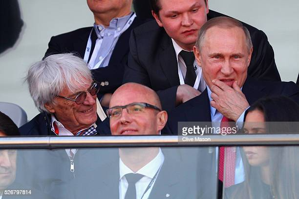 President of Russia Vladimiur Putin takes his seat next to F1 supremo Bernie Ecclestone during the Formula One Grand Prix of Russia at Sochi Autodrom...