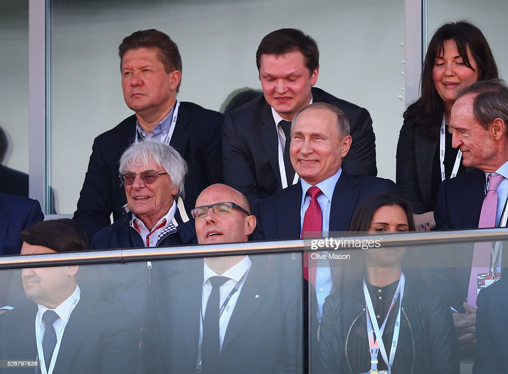President of Russia Vladimiur Putin takes his seat next to F1 supremo <a gi-track='captionPersonalityLinkClicked' href=/galleries/search?phrase=Bernie+Ecclestone&family=editorial&specificpeople=211579 ng-click='$event.stopPropagation()'>Bernie Ecclestone</a> during the Formula One Grand Prix of Russia at Sochi Autodrom on May 1, 2016 in Sochi, Russia.