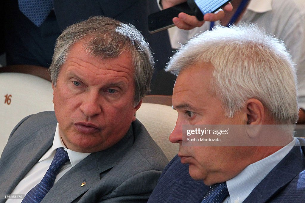 President of Russian oil company Rosneft <a gi-track='captionPersonalityLinkClicked' href=/galleries/search?phrase=Igor+Sechin&family=editorial&specificpeople=756791 ng-click='$event.stopPropagation()'>Igor Sechin</a> (L) and President of Russian oil company Lukoil Vagit Alekperov attend a meeting with Russian President Vladimir Putin and Azerbaijani President Ilham Aliyev August 13, 2013 in Baku, Azerbaijan. Putin is in Azerbaijan for a one-day state visit.