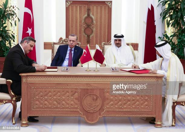 President of Scientific and Technological Research Council of Turkey Arif Ergin signs an agreement on behalf of Turkey as he is flanked by President...