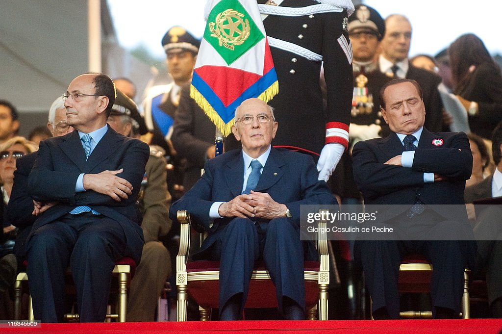 President of Senate <a gi-track='captionPersonalityLinkClicked' href=/galleries/search?phrase=Renato+Schifani&family=editorial&specificpeople=4851265 ng-click='$event.stopPropagation()'>Renato Schifani</a>, President of Italian Republic <a gi-track='captionPersonalityLinkClicked' href=/galleries/search?phrase=Giorgio+Napolitano&family=editorial&specificpeople=568986 ng-click='$event.stopPropagation()'>Giorgio Napolitano</a> and Prime Minister <a gi-track='captionPersonalityLinkClicked' href=/galleries/search?phrase=Silvio+Berlusconi&family=editorial&specificpeople=201842 ng-click='$event.stopPropagation()'>Silvio Berlusconi</a> attend the military parade to mark the 197th anniversary of Carabinieri Corp Foundation and the 150th anniversary of the Italian Republic, on June 6, 2011 in Rome, Italy. The Carabinieri Corps was created in Cagliari in June 1814 by Vittorio Emanuele I of Savoy, King of Sardinia, in order to give the kingdom a police force similar to the French Gendarmerie. The Carabinieri Corps is one of four Italian armed forces, with self-positioning within the Ministry of Defence. It is a force of military police for public security.