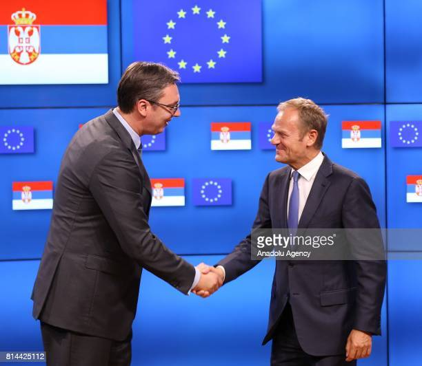 President of Serbia Aleksandar Vucic and European Council President Donald Tusk shake their hands during a joint press conference following their...