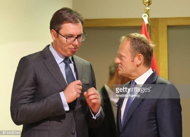 President of Serbia Aleksandar Vucic and European Council President Donald Tusk talk each other prior to a press conference following their meeting...