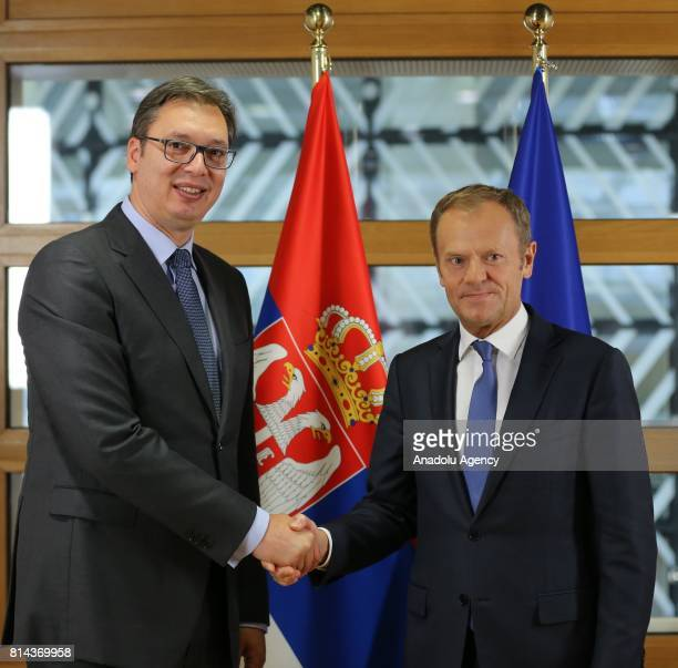 President of Serbia Aleksandar Vucic shakes hands with European Council President Donald Tusk ahead of their meeting in Brussels Belgium on July 14...