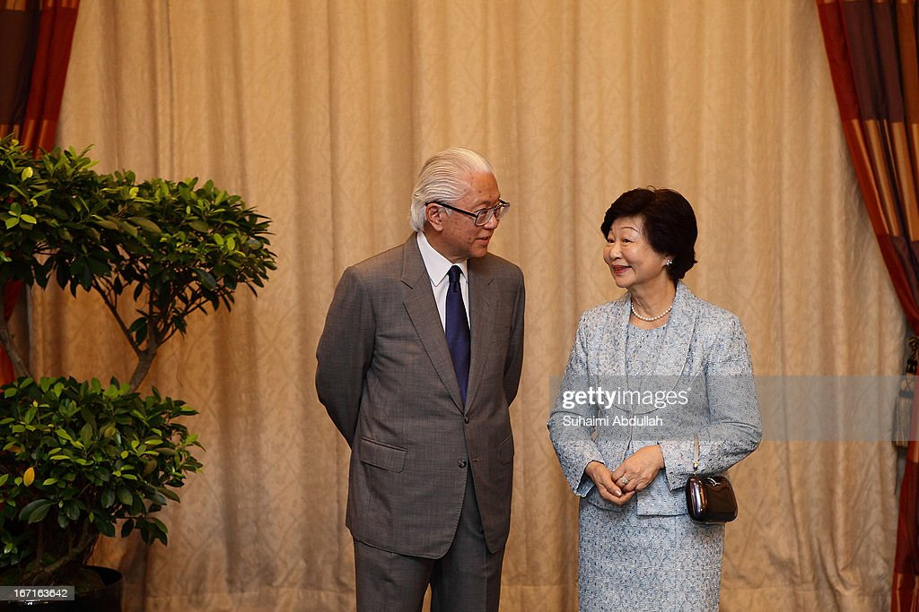 President of Singapore, Dr Tony Tan (L) shares a light hearted moment with his wife, Mary Chee as they await the arrival of the President of the Republic of Indonesia, Dr Susilo Bambang Yudhoyono on April 22, 2013 in Singapore. It is reported that President Susilo Bambang Yudhoyono will hold a Leaders' Retreat with Singapore Prime Minister Lee Hsien Loong as part of the visit.