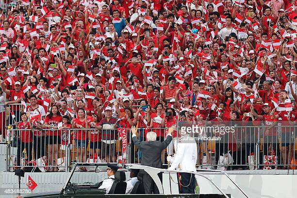 President of Singapore Tony Tan Keng Yam waves to the audience during the National Day Parade at Padang on August 9 2015 in Singapore Singapore is...