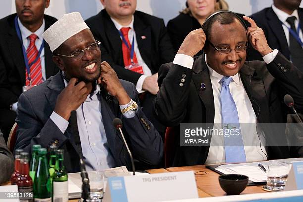 President of Somalia Sheikh Sharif Ahmed and Prime Minister of Somalia Abdiweli Mohamed Ali react during the Somalia Conference at Lancaster House on...