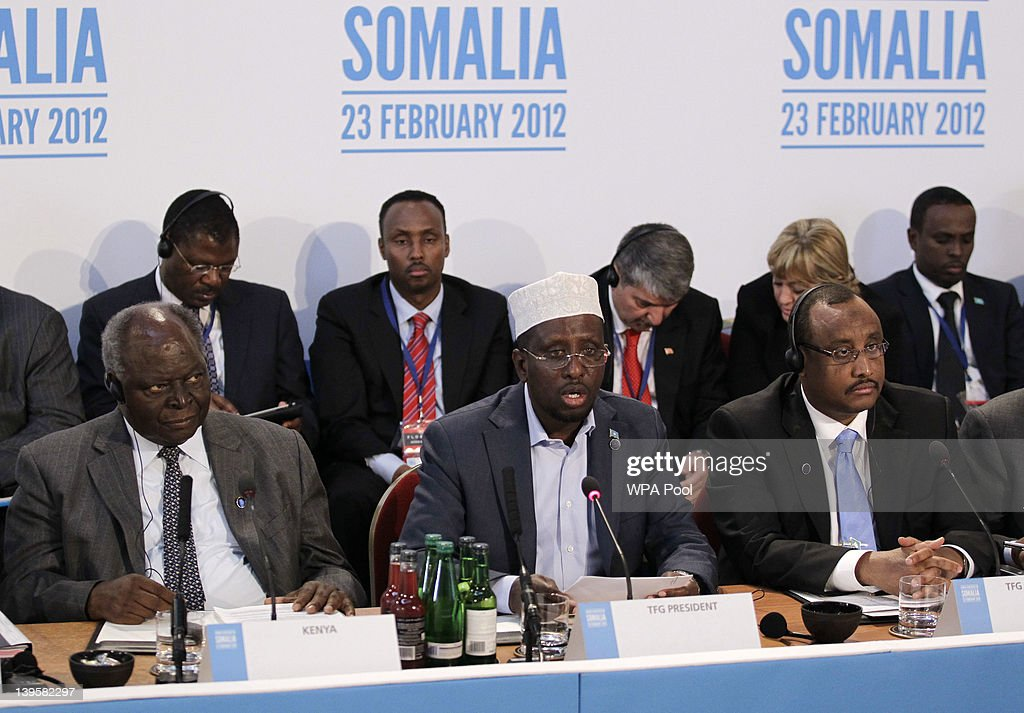President of Somalia Sheikh Sharif Ahmed (C) talks as President of Kenya <a gi-track='captionPersonalityLinkClicked' href=/galleries/search?phrase=Mwai+Kibaki&family=editorial&specificpeople=274745 ng-click='$event.stopPropagation()'>Mwai Kibaki</a> (L) and Prime Minister of Somalia TFG, Abdiweli Mohamed Ali listen on during the Somalia Conference at Lancaster House on February 23, 2012 in London, United Kingdom. Britain's Prime Minister David Cameron has invited US Secretary Of State Hillary Clinton, UN Secretary General Ban Ki Moon and representatives from over 40 governments to participate in the London Conference on Somalia, to discuss the rebuilding of Somalia and the tackling of piracy, terrorism and famine.