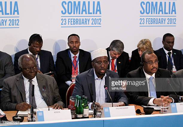 President of Somalia Sheikh Sharif Ahmed talks as President of Kenya Mwai Kibaki and Prime Minister of Somalia TFG Abdiweli Mohamed Ali listen on...