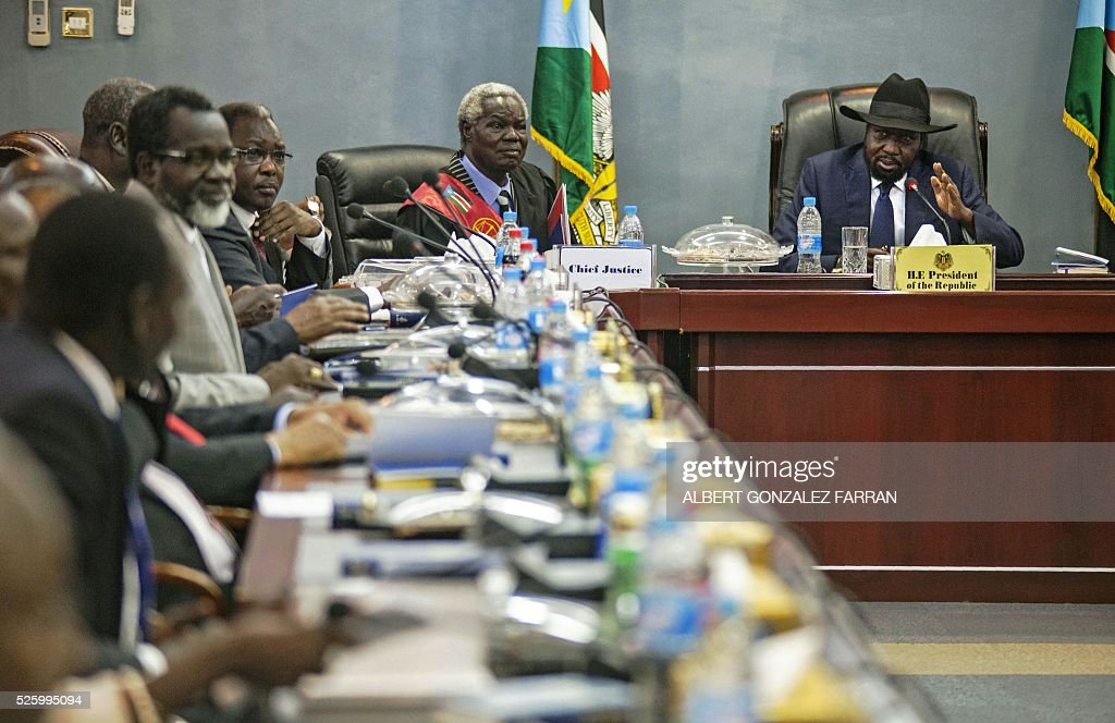 President of South Sudan Salva Kiir (R) addresses the 30 newly elected members of the cabinet of the Transitional Government at the Cabinet Affairs Ministry in Juba on April 29, 2016. South Sudan President Salva Kiir has named his transitional unity government, sharing power with ex-rebels in a key step in a long-delayed peace process, a decree read out on April 29 said. Under terms of an August 2015 peace deal, the 30 ministerial posts are split between Kiir, former rebel chief turned first vice president Riek Machar, opposition and other parties. FARRAN