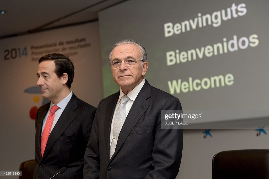 President of Spain's biggest savings bank La Caixa Isidre Faine (R) poses with CaixaBank's Chief Executive Officer Gonzalo Gortazar (L) prior to giving a press conference announcing the 2014 year results on January 30, 2015 in Barcelona. AFP PHOTO/JOSEP LAGO