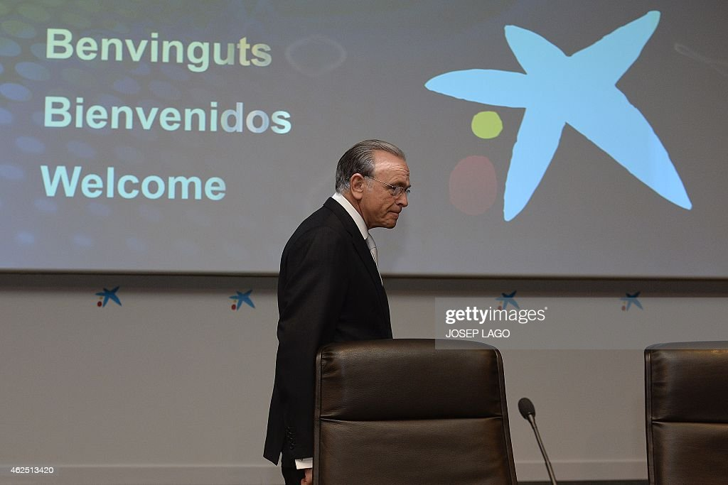 President of Spain's biggest savings bank La Caixa, Isidre Faine, arrives to give a press conference to announce the 2014 year results on January 30, 2015 in Barcelona. AFP PHOTO/JOSEP LAGO
