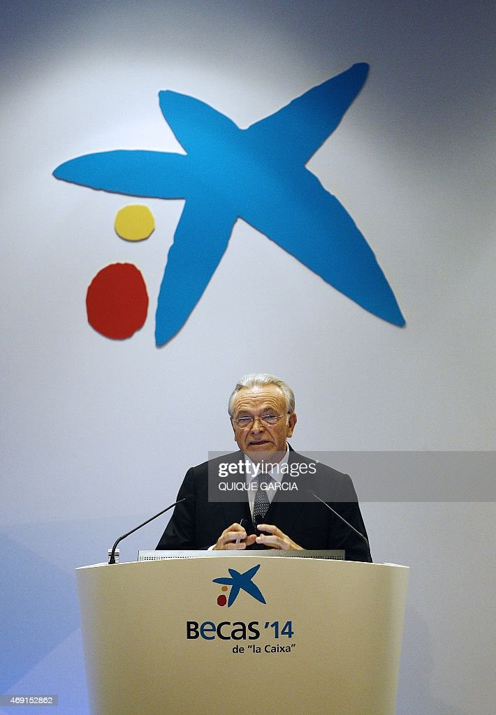 President of Spanish bank La Caixa Isidre Faine speaks during the 33rd edition of the Caixa scholarship award ceremony in Barcelona on April 10, 2015. Some 120 students selected are awarded scholarships for postgraduate studies at universities around the world; 65 in Europe, 48 in North America and 7 in Asia. AFP PHOTO / QUIQUE GARCIA