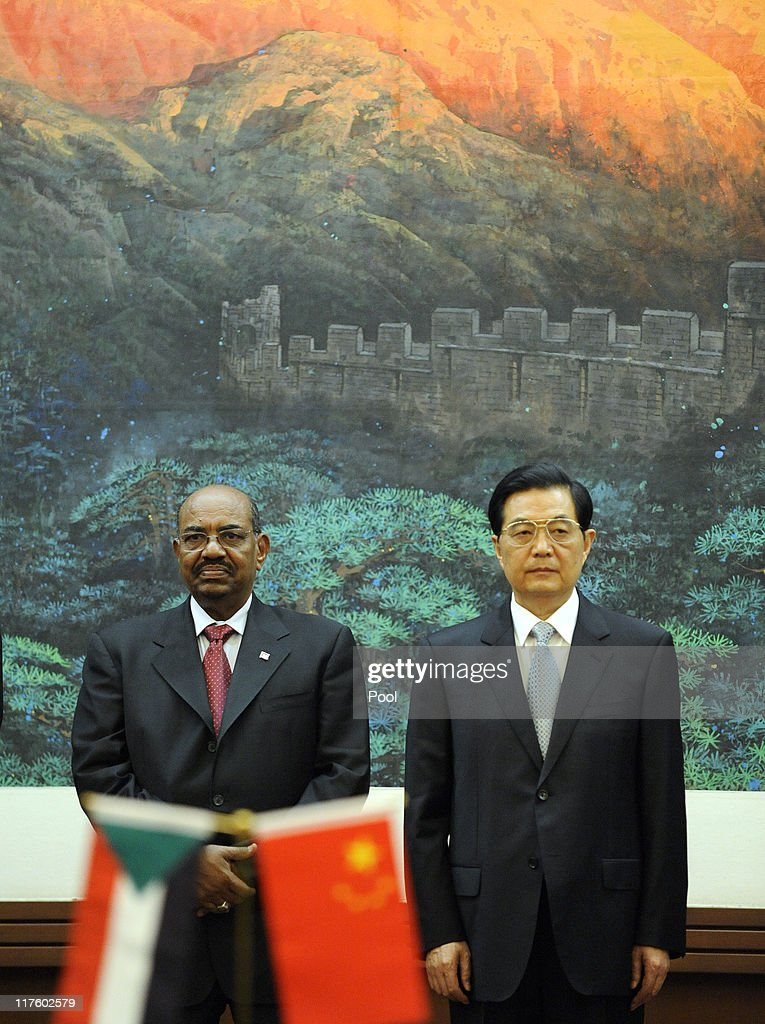 President Of Sudan Omar al-Bashir and Chinese President <a gi-track='captionPersonalityLinkClicked' href=/galleries/search?phrase=Hu+Jintao&family=editorial&specificpeople=203109 ng-click='$event.stopPropagation()'>Hu Jintao</a> attend the signing ceremony at the Great Hall of the People on June 29, 2011 in Beijing, China. Omar al-Bashir, who is wanted by the International Criminal Court for alleged war crimes, is on a four-day visit to China.