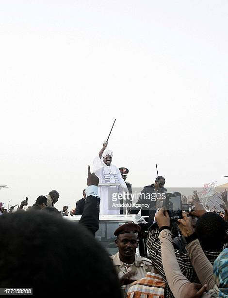 President of Sudan Omar alBashir arrives at Khartoum airport from South Africa during a group of Sudanese welcome him on June 15 2015 in Khartoum...