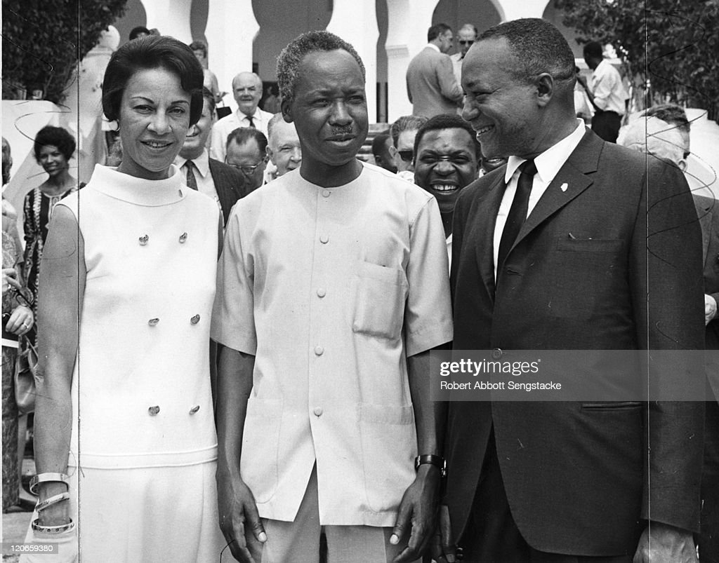 President of Tanzania <a gi-track='captionPersonalityLinkClicked' href=/galleries/search?phrase=Julius+Nyerere&family=editorial&specificpeople=228294 ng-click='$event.stopPropagation()'>Julius Nyerere</a> (1922 - 1999) (center) poses with American newspaper publisher <a gi-track='captionPersonalityLinkClicked' href=/galleries/search?phrase=John+H.+Sengstacke&family=editorial&specificpeople=1410669 ng-click='$event.stopPropagation()'>John H. Sengstacke</a> (1912 - 1997) and his wife <a gi-track='captionPersonalityLinkClicked' href=/galleries/search?phrase=Myrtle+Sengstacke&family=editorial&specificpeople=7725791 ng-click='$event.stopPropagation()'>Myrtle Sengstacke</a> (1914 - 1990), early 1960s.