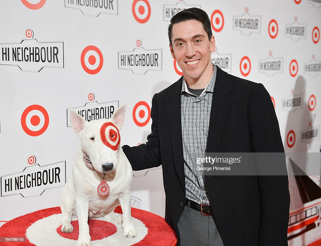 President of Target Canada <a gi-track='captionPersonalityLinkClicked' href=/galleries/search?phrase=Tony+Fisher&family=editorial&specificpeople=213031 ng-click='$event.stopPropagation()'>Tony Fisher</a> poses with Target Bullseye Dog at the opening of Target At Shoppers World Danforth on March 27, 2013 in Toronto, Canada.
