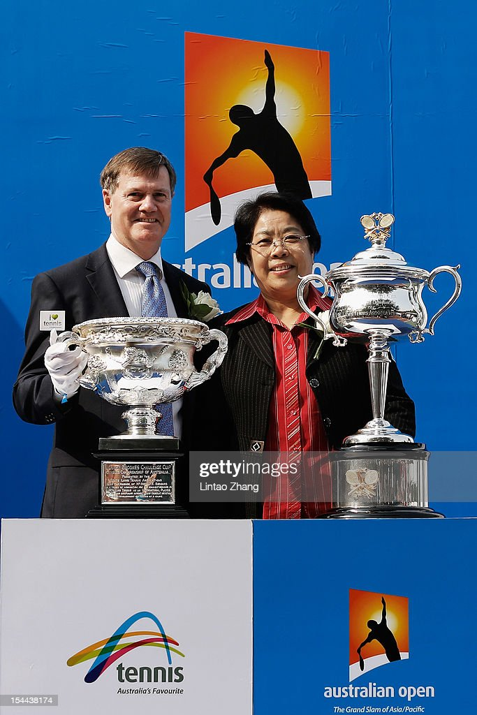 President of Tennis Australia Stephen Healy and Vice Chairman of University Council Sulan Yu pose for photographers during the Australian Open Trophies Tour at The Beijing University on October 20, 2012 in Beijing, China.