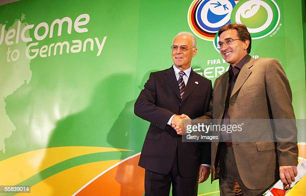 President of the 2006 world cup organizing committee Franz Beckenbauer shakes hands with Iran's national soccer team coach Branko Ivankovic at the...