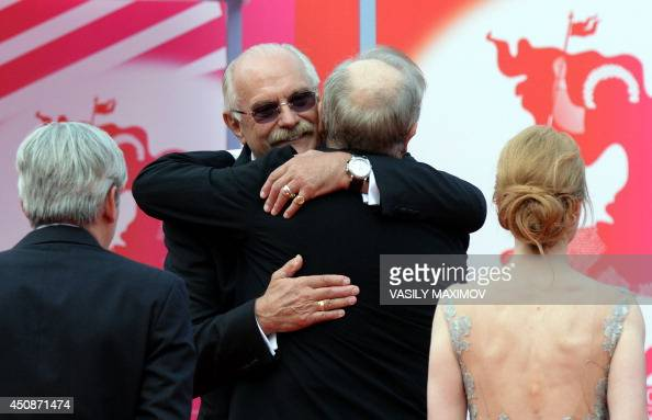 President of the 36th Moscow International Film Festival Nikita Mikhalkov hugs guests upon their arrival at the opening ceremony on June 19 2014 in...