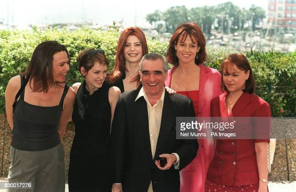 President of the 51st Cannes Film Festival Jury director Martin Scorsese takes a photo as he is joined by the female members of the jury on the roof...