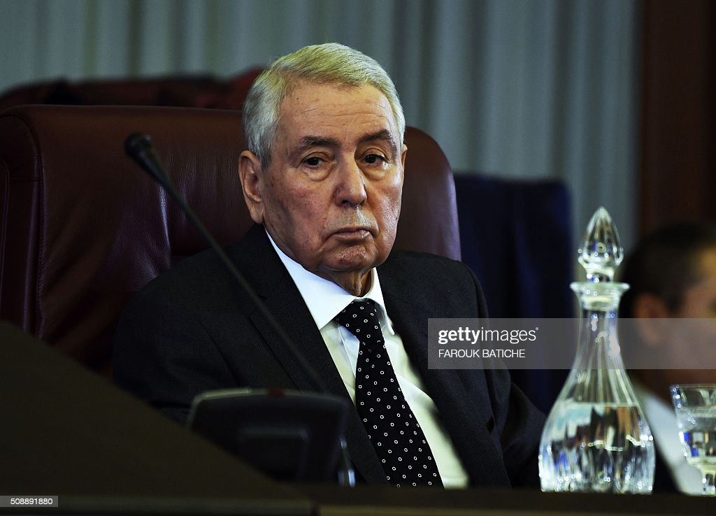 President of the Algerian Senate, Abdelkader Bensalah, chairs a parliamentary session to adopt a package of constitutional reforms on February 7, 2016, in the capital Algiers. Algeria's parliament adopted the constitutional reforms that authorities say will strengthen democracy, but opponents doubt it will bring real change. The reforms are meant to address longstanding public grievances in the North African nation, and possibly to prepare for a smooth transition amid concerns over the health of 78-year-old President Abdelaziz Bouteflika. / AFP / Farouk Batiche