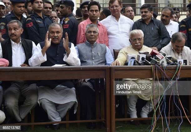 President of the All India Jat Aarakshan Sangarsh Samiti Yashpal Malik with Haryana CM Manohar Lal Khattar addressing the joint press conference...