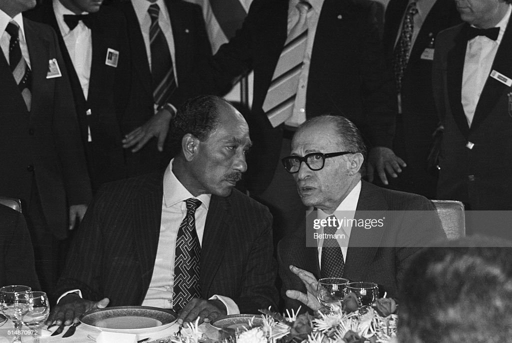 President of the Arab Republic of Egypt Anwar el-Sadat (L) and Israeli Prime Minister <a gi-track='captionPersonalityLinkClicked' href=/galleries/search?phrase=Menachem+Begin&family=editorial&specificpeople=93758 ng-click='$event.stopPropagation()'>Menachem Begin</a> (R) at a dinner at the King David Hotel on Nov. 20th, 1977. The two men later received the Noble Prize for Peace in 1978 for signing the Camp David Accord for peace.