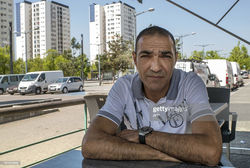 President of the AS Minguettes football club, Ahmed Zouak poses on April 25, 2013 in Venissieux, a suburb of Lyon, eastern France. Son of Algerian migrants, Ahmed Zouak who owns a bar in Venissieux, achieved the feat of competing with the French amateur CFA2 league AS Minguettes as far as the round of 16 in the French Cup, though defeated by Nancy professional L2 football club.