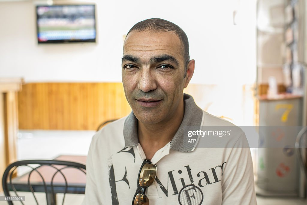 President of the AS Minguettes football club, Ahmed Zouak poses on April 25, 2013 in Venissieux, a suburb of Lyon, eastern France. Son of Algerian migrants, Ahmed Zouak who owns a bar in Venissieux, achieved the feat of competing with the French amateur CFA2 league AS Minguettes as far as the round of 16 in the French Cup, though defeated by Nancy professional L2 football club. AFP PHOTO PHILIPPE MERLE