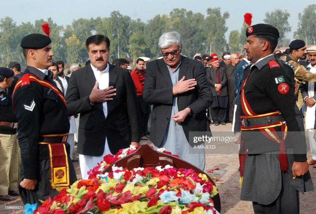 President of the Awami National Party, Asfandyar Wali Khan (2nd R), pays his respects in front of the coffin of Bashir Bilour, the number two to the chief minister of the province, during a funeral ceremony in Peshawar on December 23, 2012. Bilour was killed on December 22 when a suicide bomber stuck when around 100 people including the provincial leadership of the Awami National Party (ANP) had gathered, killing him and eight other people in northwest Pakistan, officials said, in an attack claimed by the Taliban.