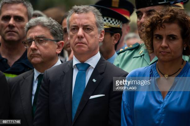 President of the Basque regional government Inigo Urkullu looks on beside Spanish Minister of Health Social Services and Equality Dolors Montserrat...