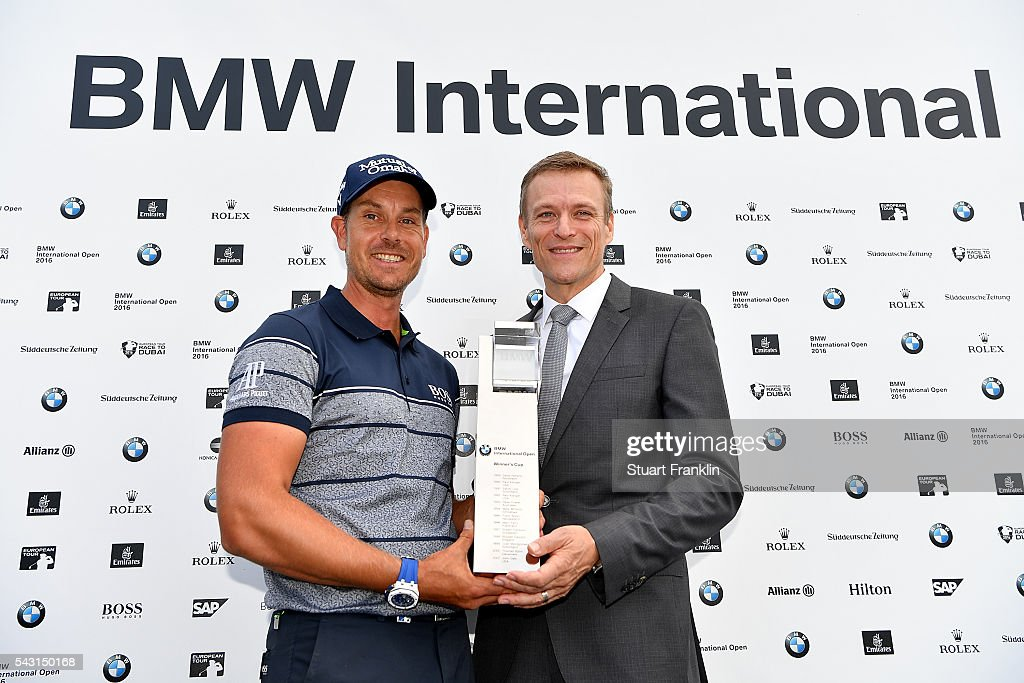 President of the BMW Group Sales Subsidiary, German Market Peter van Binsbergen presents <a gi-track='captionPersonalityLinkClicked' href=/galleries/search?phrase=Henrik+Stenson&family=editorial&specificpeople=211537 ng-click='$event.stopPropagation()'>Henrik Stenson</a> of Sweden with the trophy following his 3 shot victory during the final round of the BMW International Open at Gut Larchenhof on June 26, 2016 in Cologne, Germany.