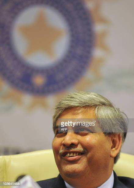 President of the Board of Control for Cricket in India Shashank Manohar smiles as he speaks during a news conference at the BCCI headquarters in...