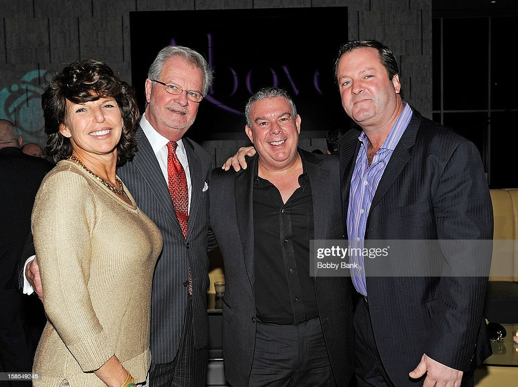 President of the board of the Staten Island Zoological Society, William J. Frew Jr. (2nd L) and <a gi-track='captionPersonalityLinkClicked' href=/galleries/search?phrase=Elvis+Duran&family=editorial&specificpeople=3048281 ng-click='$event.stopPropagation()'>Elvis Duran</a> (3rd L) and the Staten Island Zoo Board of Directors attend 2012 Staten Island Zoo Christmas Party Hosted By <a gi-track='captionPersonalityLinkClicked' href=/galleries/search?phrase=Elvis+Duran&family=editorial&specificpeople=3048281 ng-click='$event.stopPropagation()'>Elvis Duran</a> at Staten Island Hilton on December 18, 2012 in New York City.