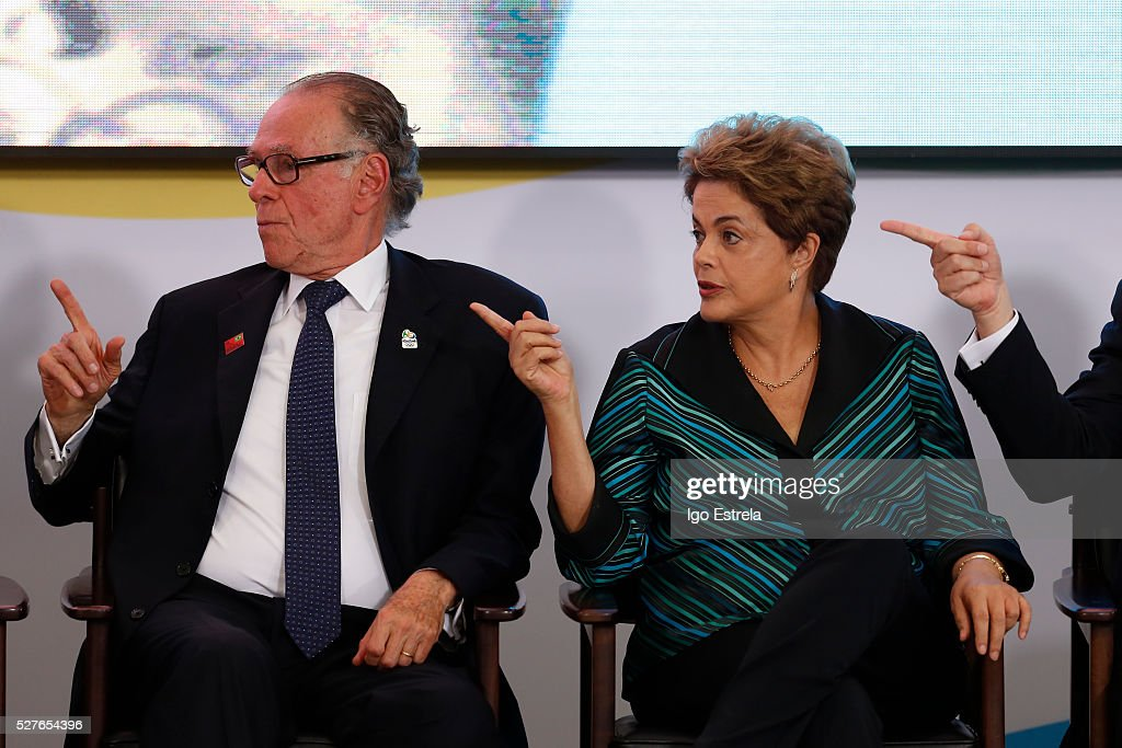 President of the Brazilian Olympic Committee Carlos Nuzman and President of Brazil <a gi-track='captionPersonalityLinkClicked' href=/galleries/search?phrase=Dilma+Rousseff&family=editorial&specificpeople=1955968 ng-click='$event.stopPropagation()'>Dilma Rousseff</a> attend a ceremony where the pyre and the Olympic torch are lit to start the relay at the Planalto Palace on May 3, 2016 in Brasilia, Brazil. The Olympic torch will pass through 329 cities from all states in Brazil before arriving in Rio de Janeiro on August 5, for the lighting of the cauldron.