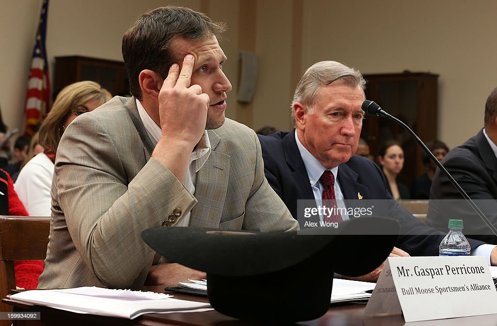 President of the Bull Moose Sportsmen's Alliance Gaspar Perricone (L) and gun owner and NRA member James Cummings (R) testify during a hearing before the Congressional Gun Violence Prevention Task Force January 23, 2013 on Capitol Hill in Washington, DC. The task force held a hearing on 'the comprehensive steps that Congress can take to reduce gun violence while respecting the 2nd Amendment rights of law-abiding Americans.'