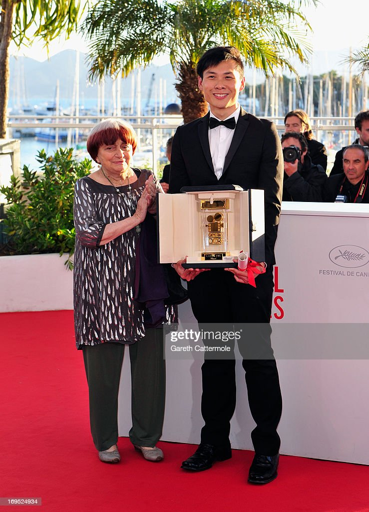 President of the Camera d'Or jury Agnes Varda and Director Anthony Chen, winner of the 'Camera d'Or' for Best First Film attend the Palme D'Or Winners Photocall during the 66th Annual Cannes Film Festival at the Palais des Festivals on May 26, 2013 in Cannes, France.