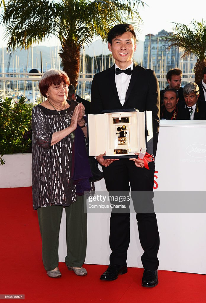 President of the Camera d'Or jury <a gi-track='captionPersonalityLinkClicked' href=/galleries/search?phrase=Agnes+Varda&family=editorial&specificpeople=234558 ng-click='$event.stopPropagation()'>Agnes Varda</a> and director Anthony Chen pose after receiving the Camera d'Or for 'Ilo Ilo' at the photocall for award winners during the 66th Annual Cannes Film Festival at Palais des Festivals on May 26, 2013 in Cannes, France.